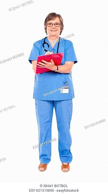 Senior female doctor writing on clipboard