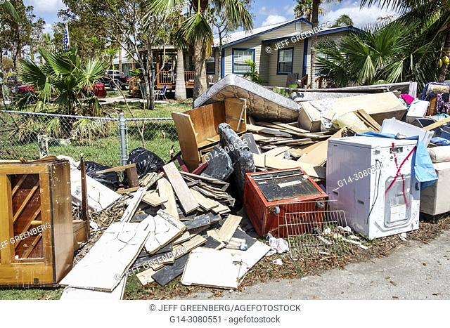 Florida, Everglades City, after Hurricane Irma, houses homes residence, storm disaster recovery cleanup, surge flood damage destruction aftermath, trash
