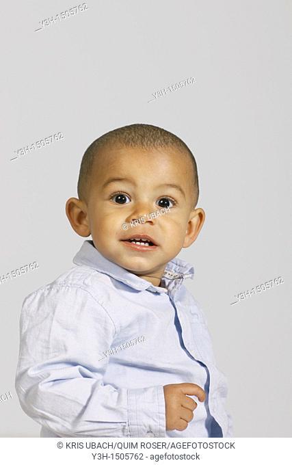 Studio shot of little boy