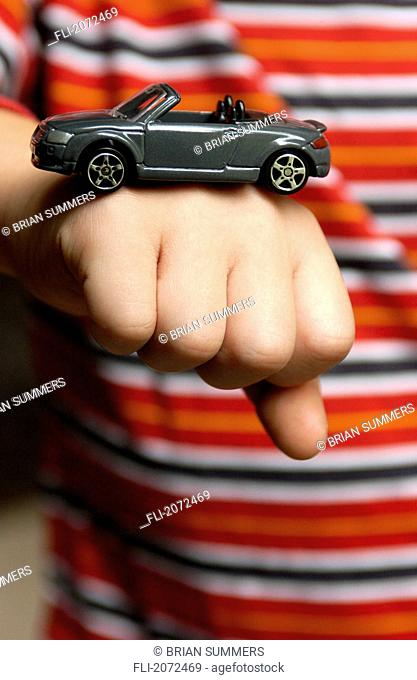 Boy With Toy Car On His Fist