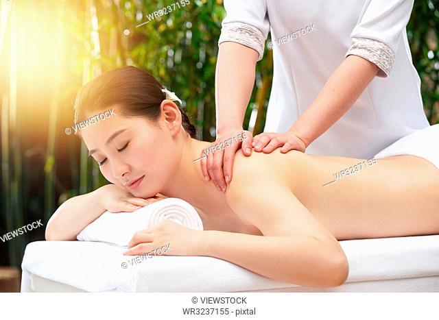 The young woman in the outdoor SPA