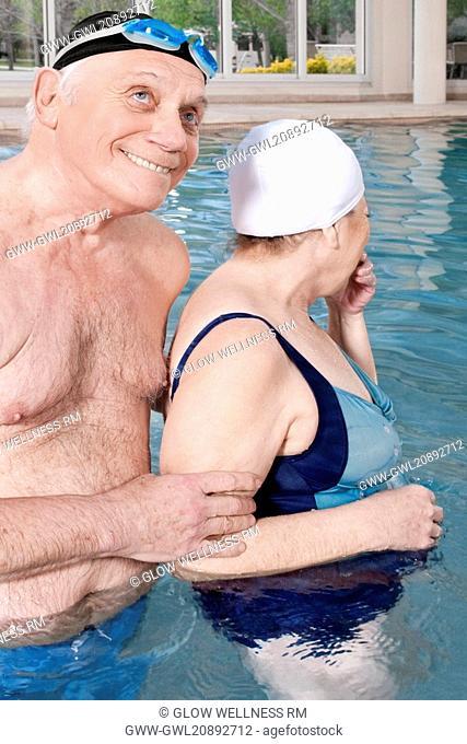 Couple enjoying in a swimming pool