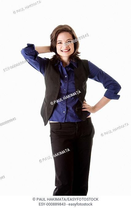 Beautiful young caucasian brunette business student woman standing with hand on hip and behind head smiling, wearing blue blouse and black jacket, isolated
