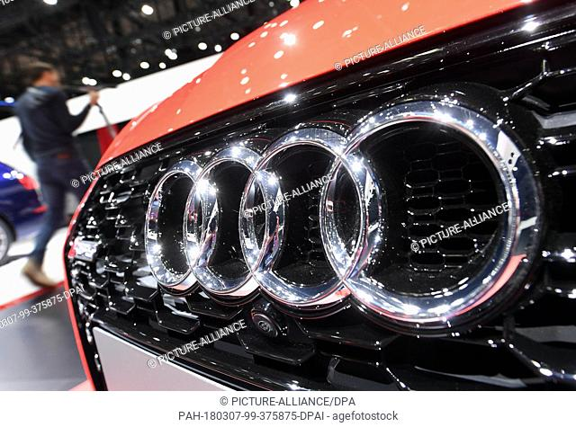 07 March 2018, Switzerland, Geneva: The logo of carmaker Audi is displayed on the bonnet of an exhibited car during the 2nd Press Day at the 2018 Geneva Motor...