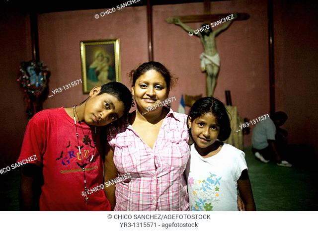 Central American migrants traveling across Mexico to work in the United States pose for a picture at the Catholic priest Alejandro Solalinde's shelter Hermanos...