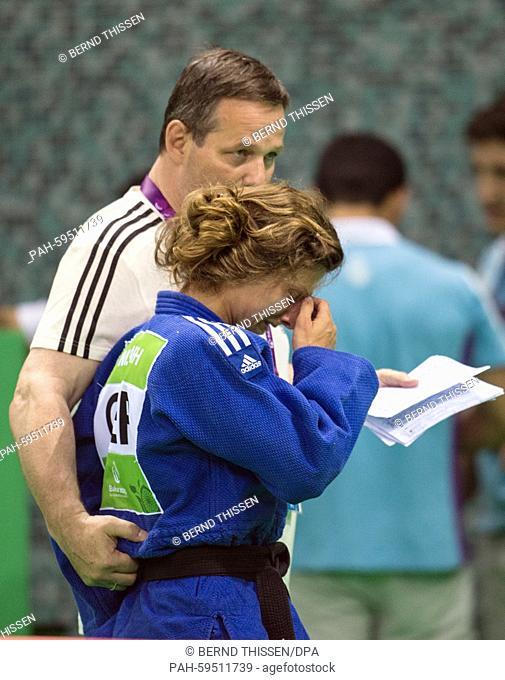 Germanys Mareen Kraeh cries after loosing in the Women's -52kg Judo Women's Semifinal of Table B at the Baku 2015 European Games in Heydar Aliyev Arena in Baku