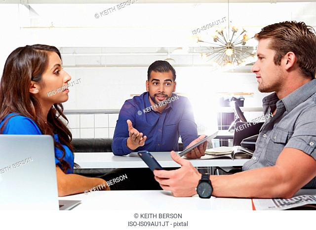 Small group of people having business meeting, male and female colleagues having disasgreement