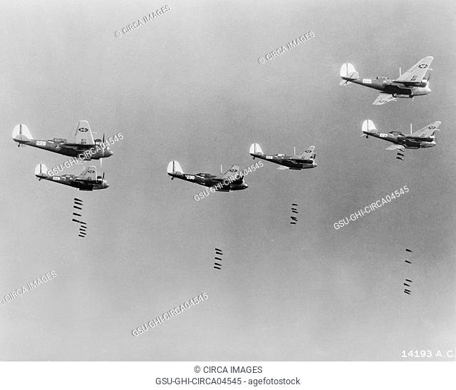 600-pound Bombs falling from Formation of B-10 Bombers in Bombing Practice by 19th Bombardment Group, U.S. Army Air Corps, Office of War Information