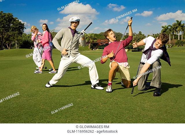Five friends having fun in a golf course, Biltmore Golf Course, Coral Gables, Florida, USA