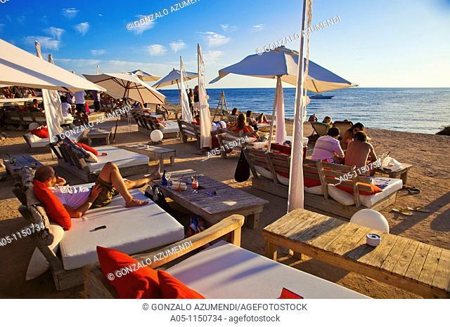 Restaurant Cap des Falco. Chiringuito. Es Codolar Beach. Ses Salines Natural Park. Young people enjoying the Sunset. Ibiza. Balearic Islands  Spain