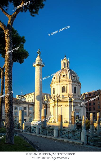 Trajan's Column and ruins of Trajan's Forum with Santissimo Nome di Maria church beyond, Rome Lazio Italy