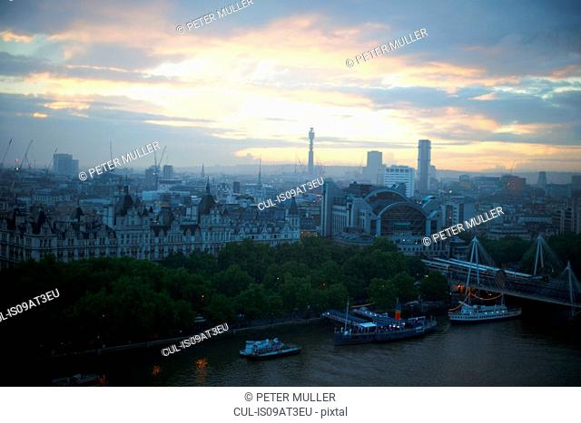 High angle view of river Thames and waterfront at dawn, London, England, UK