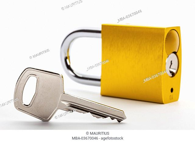 Key beside locked padlock, symbol, savety