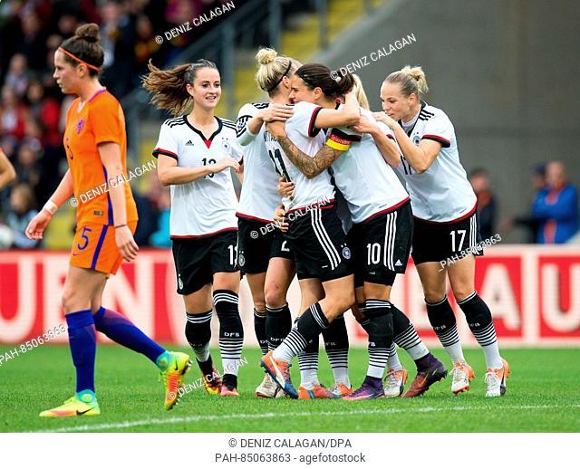 Germany's Sara Daebritz, Tabea Kemme, goal-scorer Anja Mittag, Dzsenifer Marozsan, Isabel Kerschowski celebrate the 3-1 goal during the women's international...
