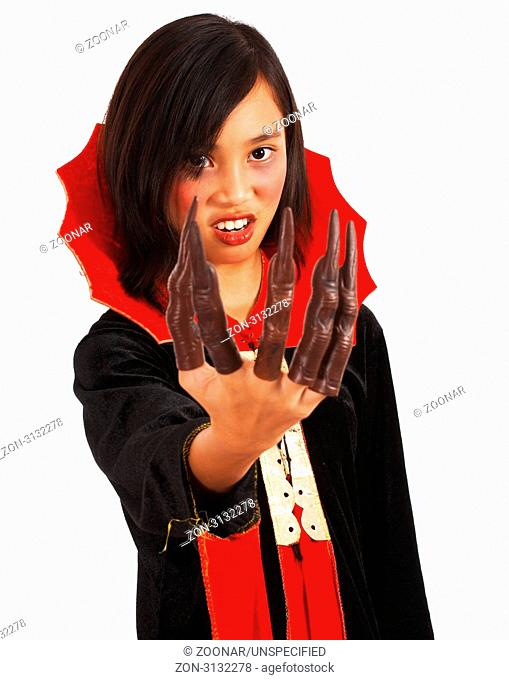 Girl Dressed In Dracula Costume And Fake Long Fingers