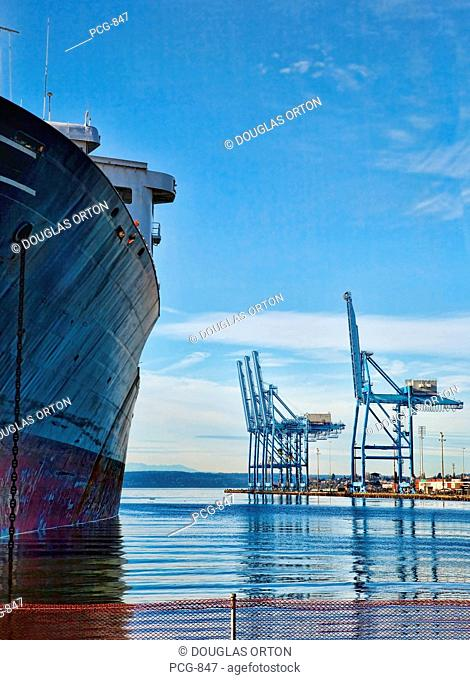 A container ship lies at berth in the Sitcum Waterway of Commencement Bay. Commencement Bay's history of industry and shipping has led to EPA Superfund...