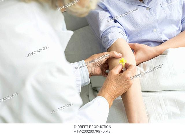 Doctor preparing infusion needle