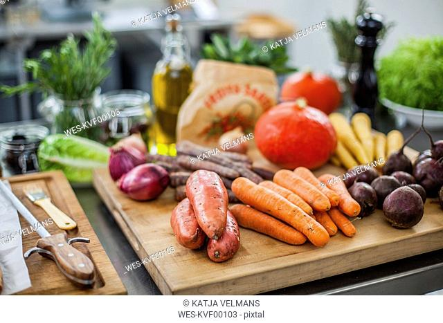 Different fresh vegetables on chopping board