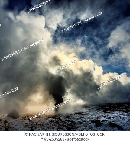 Person by the steam, Namaskard Geothermal Volcanic area, Northern Iceland