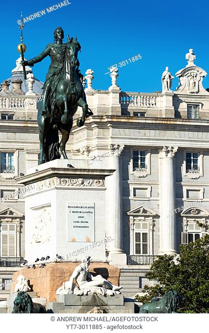 Madrid, Spain. Plaza de Oriente with Palacio Real, or Royal Palace background. Equestrian statue of Philip IV by Pietro Tacca
