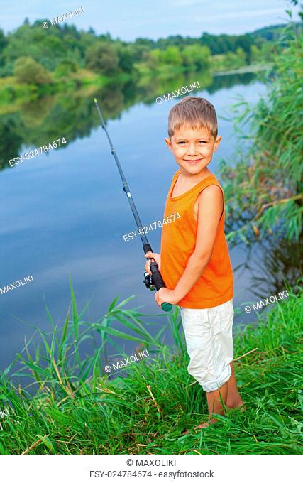 Summer vacation - Photo of little boy fishing on the river
