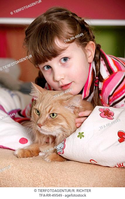 girl with siberian cat