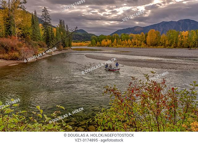 Fall Fly Fisherman in Float Boat on North Fork Flathead River Glacier National Park Montana USA