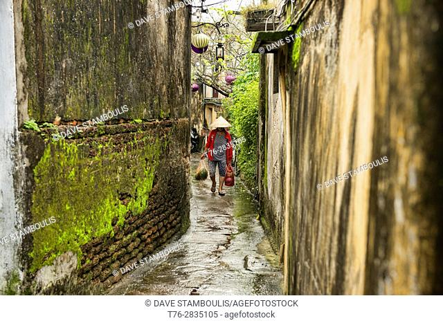 The narrow lanes of atmospheric old town, Hoi An, Vietnam