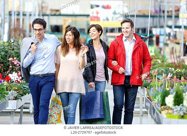 Couples buying flowers, garden center