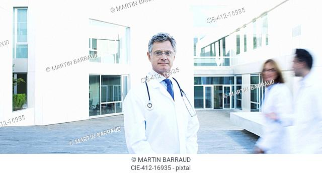 Portrait of confident doctor on rooftop