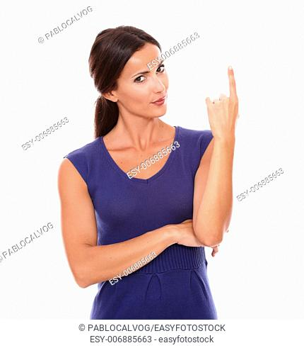 Beautiful young female pointing up smiling and looking at you in white background - copyspace