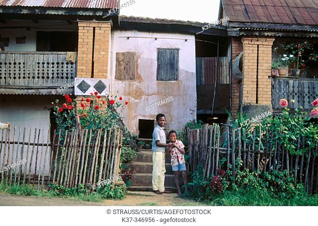Village homes showing vestiges of French colonial architecture with shutters, brickwork and balconies. Republic of Madagascar