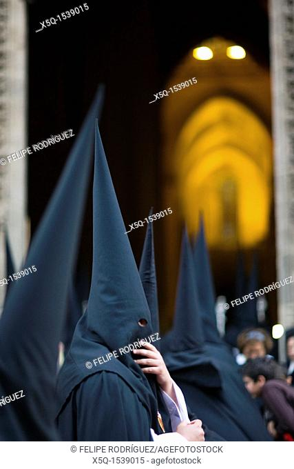Hooded penitents entering Seville's cathedral, Holy Week 2008