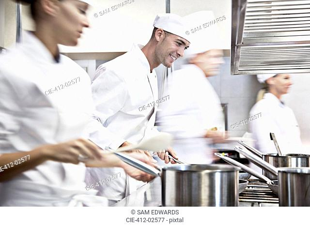 Chefs cooking in restaurant kitchen