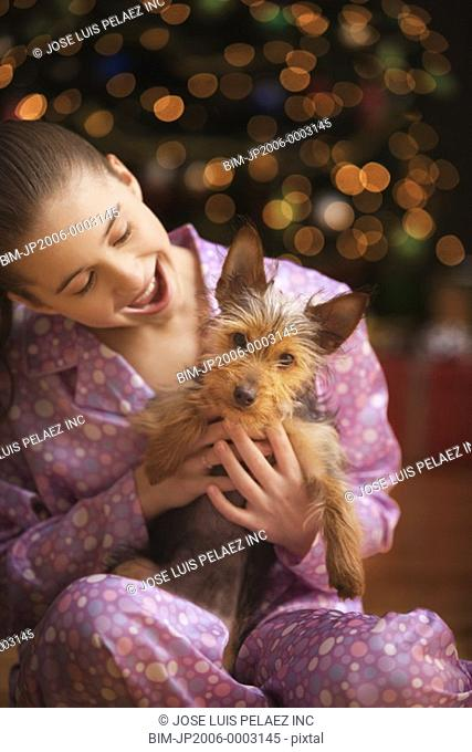 Girl holding Yorkshire Terrier puppy