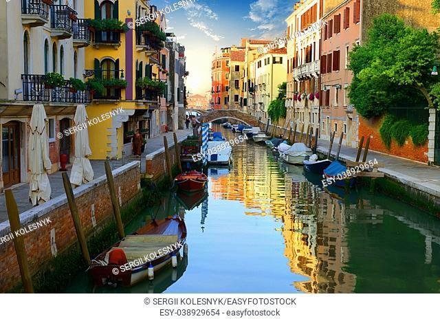 Boats in narrow venetian water canal, Italy