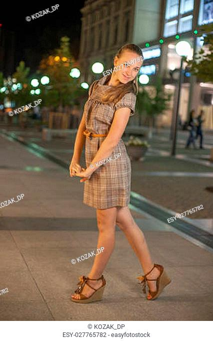 Beautifull girl stay at the square in the night