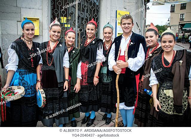 A group of young poses for photographer dressed in traditional costume during the holiday Llanes Guide. Llanes. Asturias. Spain