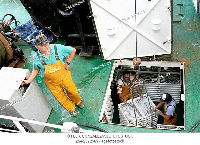 Unloading fish boxes, port of Aviles, Asturias Spain