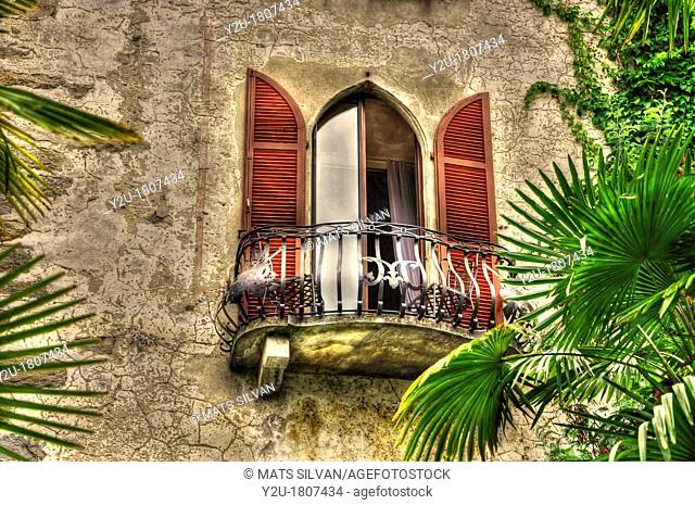 Old balcony with palm leaves