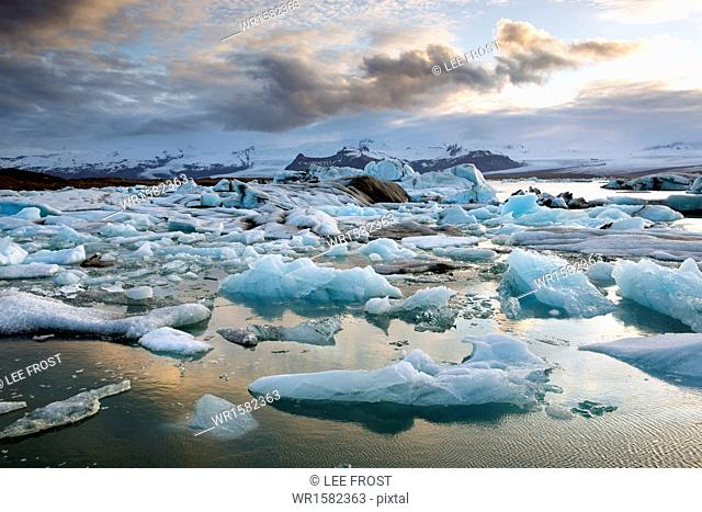 Sunset over Jokulsarlon, a glacial lagoon at the head of the Breidamerkurjokull Glacier on the edge of the Vatnajokull National Park, South Iceland, Iceland