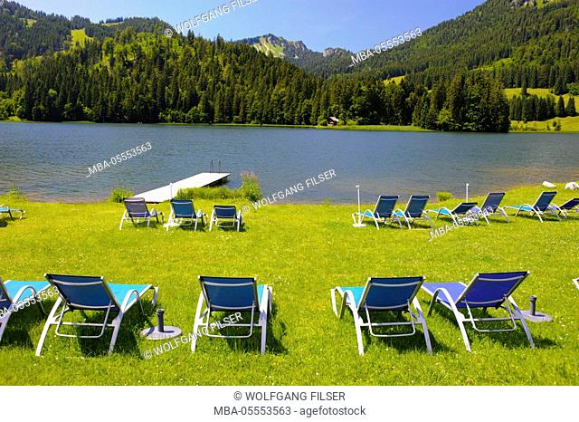 Beach at the Spitzingsee close empty deck chairs shows lull at the tourism