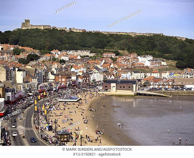 Busy beach at South Bay below Castle Hill in Scarborough Yorkshire England