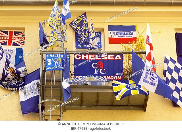 Chelsea football fan decorates his balcony with flags