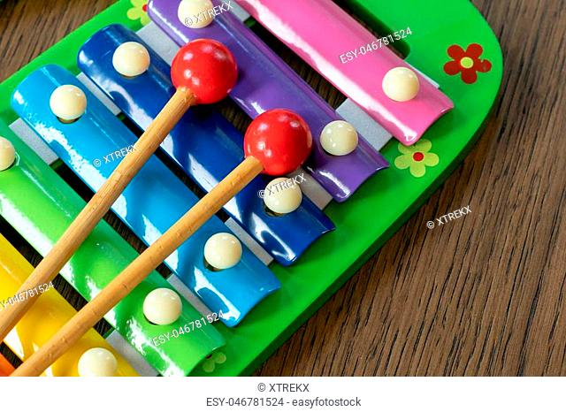 Musical instrument xylophone. Rainbow colored toy xylophone