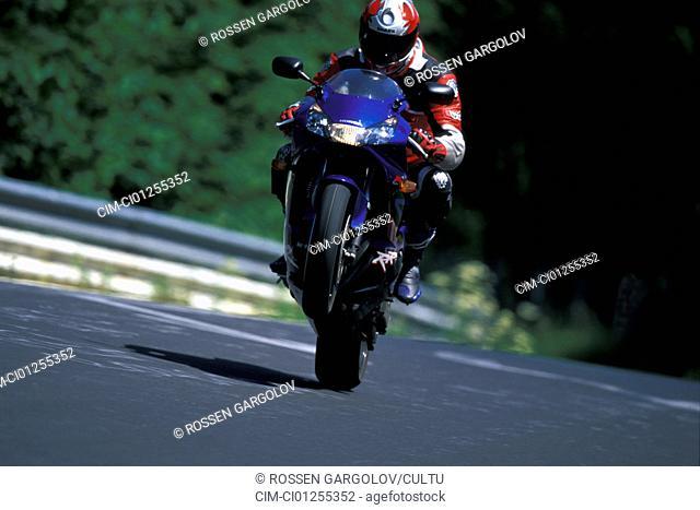 Sports motor cycle, Sportsman, Honda Fireblade, blue, model year 2003, driving, High starter, Wheely, from the front, photographer Gargolov