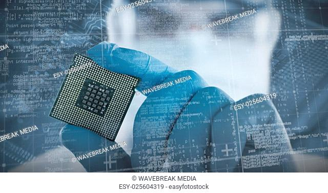 Composite image of male doctor in protective glasses and surgical mask holding electronic chip