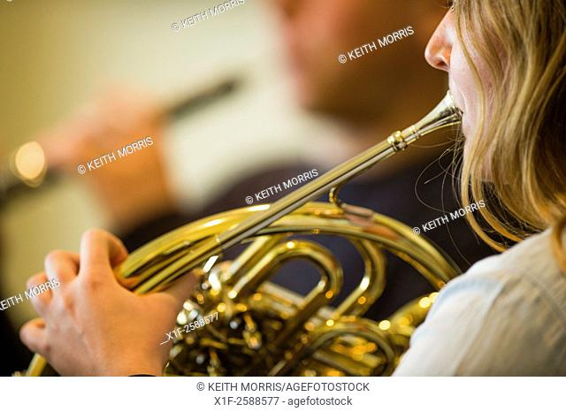 Young musicians: classical music french horn player in rehearsal at Aber Music Fest festival 2015