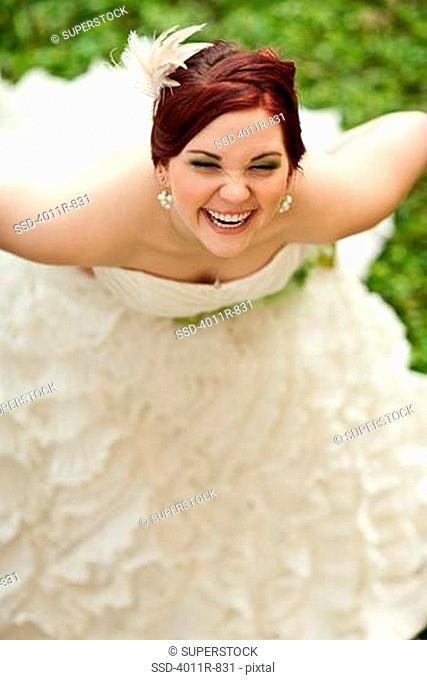 Bride laughing outdoors