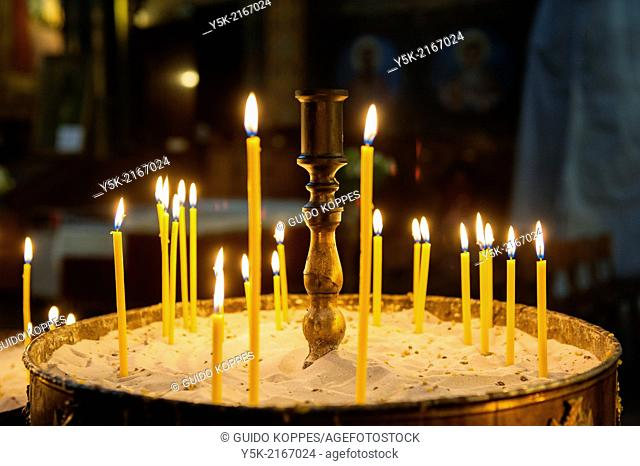 Sofia, Bulgaria. Candles on a large candlestick inside the interior of the Orthodox-Christian Sveta Nedalya church, Down Town Sofia